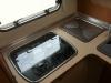 Die Küche mit dem Gasherd und der Spüle